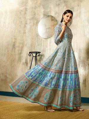 Add This Beautiful Printed Gown To Your Wardrobe In Light Blue Color Fabricated On Chanderi. This Readymade Gown Is Available In All Sizes, Choose As Per Your Desired Fit And Comfort.
