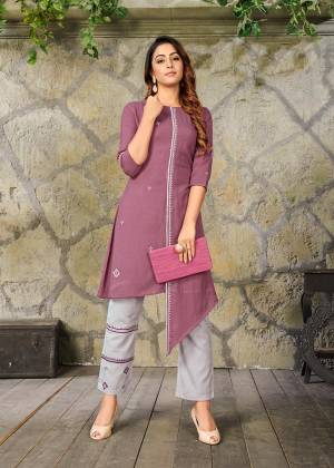 Add This Pretty Readymade Pair Of Kurti In Mauve Color Paired With Contrasting Grey Colored Bottom. Its Top And Bottom Are Fabricated On Rayon Beautified With Thread Work. It Is Available In All Regular Sizes. Buy This Pretty Pair Now.