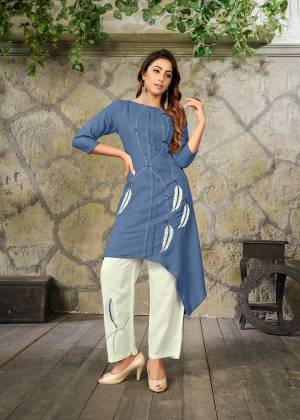 Here Is A Pretty Pair Of Kurti And Pant For Your Semi-Casual Or Festive Wear. Its Assymetric Patterned Kurti Is In Blue Color Paired With White Colored Bottom. This Readymade Pair Is Fabricated On Rayon Beautified With Thread Work.