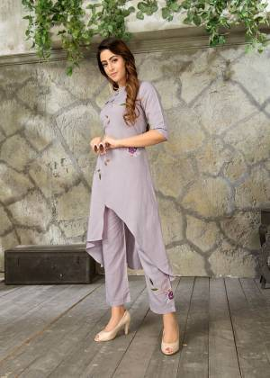 Simple and Elegant Looking Readymade Pair Of Kurti And pant Is Here In Grey Color. Its Top and Bottom are Fabricated On Rayon Which Is Soft Towards Skin And Easy To Carry All Day Long.