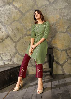 Celebrate This Festive Season With Beauty And Comfort Wearing This Readymade Kurti In Olive Green Paired With Contrasting Maroon Colored Pants. This Pretty Pair Is Fabricated On Rayon Beautified With Thread Work. Buy Now.