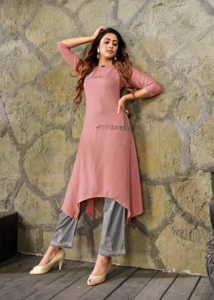 Look Pretty Wearing This Readymade Pair Of Kurti In Dusty Pink Color Paired With Contrasting Grey Colored Bottom. This Kurti And Bottom are Fabricated On Rayon Beautified With Thread Work. Buy This Pretty Piece Now.