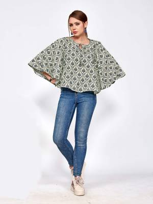 For Your College, Home Or Work Place, Grab This Designer Readymade Top In Pastel Green And Black Color Beautified With Small Prints All Over It. It Is Light In Weight And Easy To Carry All Day Long.