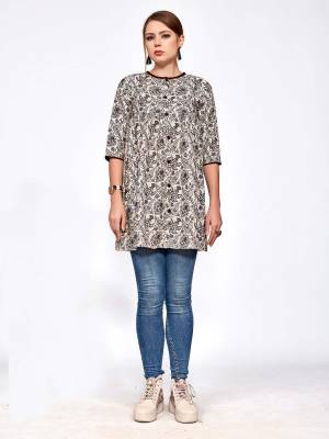 For Your College, Home Or Work Place, Grab This Designer Readymade Top In Cream And Black Color Beautified With Small Prints All Over It. It Is Light In Weight And Easy To Carry All Day Long.
