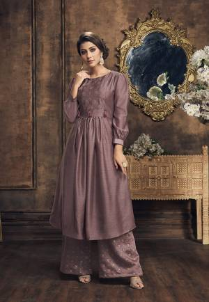 Here Is Very Pretty New Shade In Purple To Add Into Your Wardrobe With This Readymade Designer Kurti And Plazzo In Mauve Color. Its Top And Bottom Are Fabricated On Soft Silk Beautified With Foil Prints And Embroidery. Buy Now.