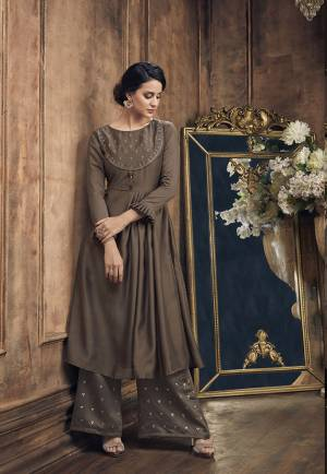 Enhance Your Personality Wearing This Rich Looking Designer Pair Of Kurti And Plazzo In Brown Color Which Is Soft Silk Based. Its Top Is Beautified With Jari And Resham Embroidered Paired With Foil Printed Bottom.