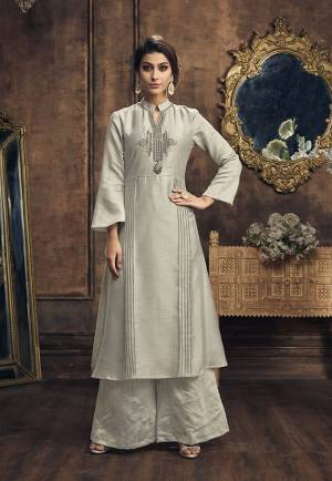 Flaunt Your Rich And Elegant Taste In This Beautiful Designer Grey Colored Kurti Paired With Grey Colored Bottom. This Readymade Pair Is Fabricated On Soft silk Beautified With Foil Prints And Embroidery.