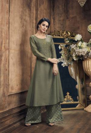 You Will Definitely Earn Lots Of Compliments Wearing This Designer Readymade Pair Of Kurti And Plazzo In Olive Green Color. This Readymadde Pair Is Fabricated On Soft Silk Beautified With Embroidery Over Top And Foil Printed Bottom.