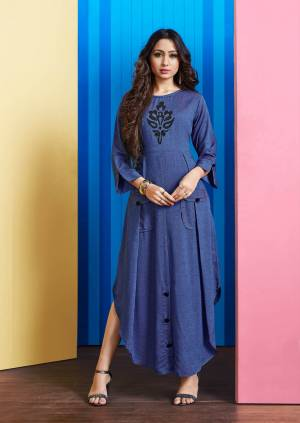 Grab This Readymade Pretty Kurti In Dark Blue Color Fabricated On Rayon Slub. This Pretty Kurti Is Patch Over The Front And Buttons.