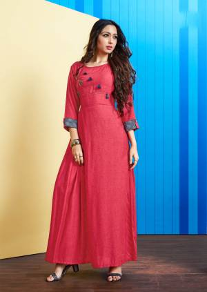 Simple And Elegant Readymade Long Kurti Is Here In Dark Pink Color. This Kurti Is Fabricated On Rayon Slub Beautified With Buttons And Tassels. It Is Light In Weight and Easy To Carry All Day Long.
