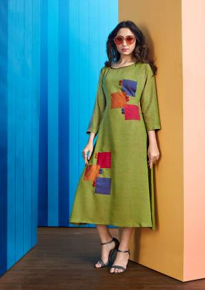 Here Is A Beautiful Patch Patterned Designer Readymade Kurti In Green Color Fabricated On Rayon Slub. It Has Multi Colored Patch Swatches With Buttons.