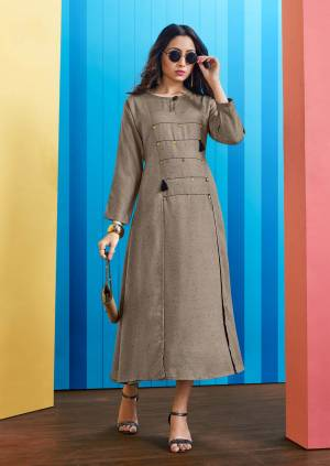 Elegant And rich Looking Designer Readymade Kurti Is Here In Grey Color Fabricated On Rayon Slub. This Kurti IS Beautified With Buttons And Tassels. Also It Is Light Weight And Durable.