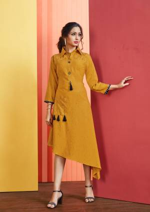 Asymmetric Patterned Readymade Kurti Is Here In Musturd Yellow Color Fabricated On Rayon Slub. Its Fabric Is Soft Towards Skin And Ensures Superb Comfort All Day Long.