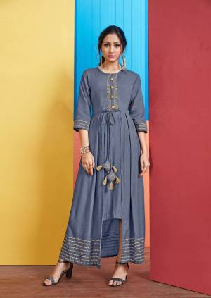 For Your Semi-Casual Wear, Grab This Designer Readymade Kurti In Blue Color With A Unique Pattern. This Kurti Is Fabricated On Rayon Slub Which Is Light Weight, Durable And Easy To Care For.