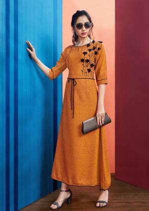 New Shade In Long Readymade Kurti Is Here In Rust Orange Color Fabricated On Rayon Slub. This Kurti Is Beautified With Thread Work And Tassels And Availble In All Regular Sizes.