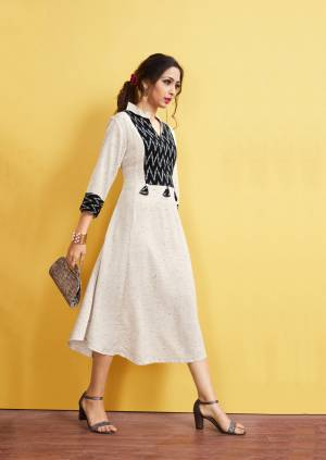 Simple And Elegant Readymade Long Kurti Is Here In Off-White Color. This Kurti Is Fabricated On Rayon Slub Beautified With Printed Pattern And Tassels. It Is Light In Weight and Easy To Carry All Day Long.
