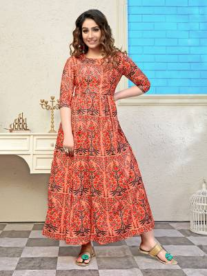 Add Some Semi-Casuals With This Readymade Long Kurti In Orange Color Fabricated Muslin. It Is Beautified With Prints All Over And Is Available In All Regular Sizes. \