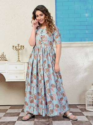 Rich And Elegant Looking Readymade Long Kurti Is Here In Steel Blue Color. It Is Fabricated On Muslin Beautified With Pretty Prints All Over. Also Its Fabric Ensures Superb Comfort all Day Long.