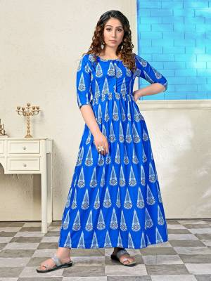 Shine Bright In This Readymade Long Kurti In Royal Blue. This Pretty All Over Printed Kurti Is Fabricated on Muslin Which Is Soft Towards Skin And Easy To Carry All Day Long.