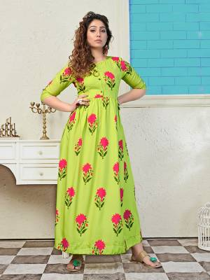 Look Pretty In This Designer Floral Printed Long Kurti In Parrot Green Color. This Readymade Kurti Is Muslin Based And Available In All Regular Sizes.
