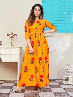 Add Some Semi-Casuals With This Readymade Long Kurti In Musturd Yellow Color Fabricated Muslin. It Is Beautified With Prints All Over And Is Available In All Regular Sizes.