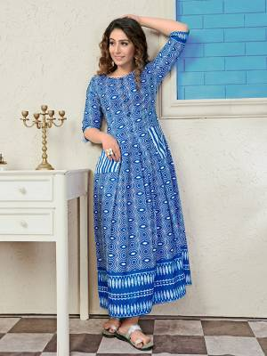 Rich And Elegant Looking Readymade Long Kurti Is Here In Blue Color. It Is Fabricated On Muslin Beautified With Pretty Prints All Over. Also Its Fabric Ensures Superb Comfort all Day Long.