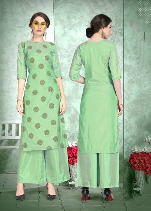 This Festive Season, Celebrate With Comfort and Charming Look By Wearing This Designer Readymade Set Of Kurti And Plazzo In Green Color. This Pretty Set Is Fabricated On Soft Art Silk Beautified With Foil Print Over The Top. Also It Is Light Weight And Easy To Carry All Day Long.