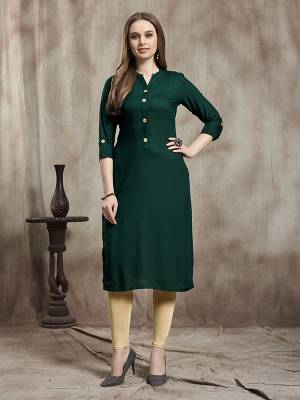 Simple And Elegant Readymade Plain Kurti Is Here In Dark Green Color For Your Casual Wear. This Kurti Is Fabricated On Rayon And Available In All Regular Sizes. It Is Suitable For College Wear, Home Or Work Place.