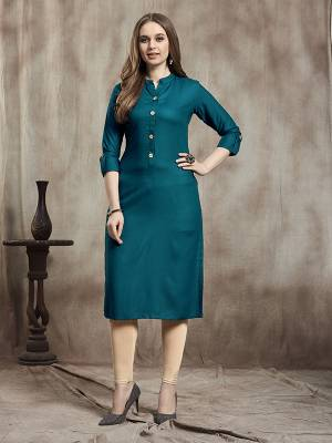 Simple And Elegant Readymade Plain Kurti Is Here In Teal Blue Color For Your Casual Wear. This Kurti Is Fabricated On Rayon And Available In All Regular Sizes. It Is Suitable For College Wear, Home Or Work Place.