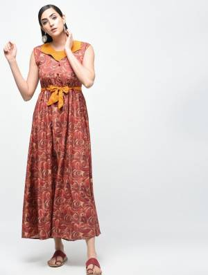 For Your Semi-Casuals, Grab This Readymade Knee Length Kurti In Brown Color Which Is Cotton Based Beautified With Prints All Over. It Is Soft Towards Skin And Easy To Carry All Day Long.