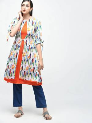 Be It Your College Wear, Home Or Work Place, This Readymade Kurti Is Suitable For All. This Orange And White Colored Knee Length Kurti Is Cotton Based Beautified With Prints.
