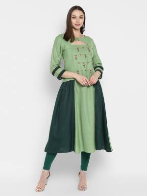 Here Is a Designer Readymade Kurti In Shades Of Green Color. This Kurti Is Silk Based Beautified With Thread Work Over The Yoke.