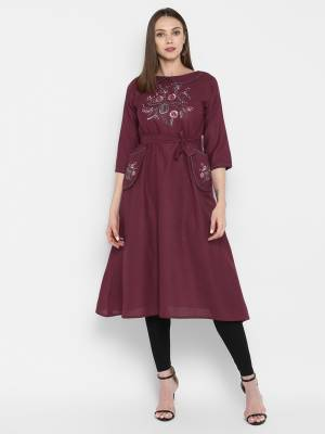Look Pretty In This Designer Readymade Silk Based Kurti In Wine Color. Its Pretty Tunic Pattern With Thread Work Will Earn You Lots Of Compliments From Onlookers.