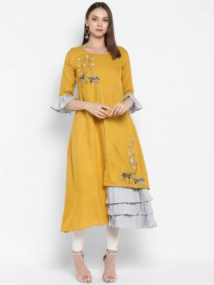Celebrate This Festive Season Wearing This Designer Readymade Kurti In Yellow Color Fabricated Rayon. Its Pretty Unique Pattern And Elegant Color Pallete Will Earn you Lots Of Compliments From Onlookers.