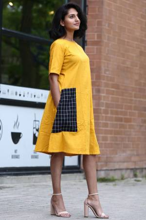 Grab This Pretty Readymade Kurti In Yellow color In Tunic Pattern Fabricated On Khadi Cotton. This Kurti Is Beautified With Printed Patch Pocket. You Can Wear It as It Or Pair This Up With Leggings Or Pants.