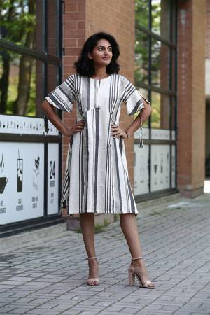 If You Are Fond Of Lining Prints Than Grab This Designer Readymade Tunic Patterned Kurti In white And Grey Color Fabricated On Khadi Cotton.