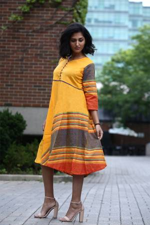 For Your Semi-Casuals, Grab This Readymade Kurti In Tunic Pattern In Musturd Yellow Color. It Is Fabricated On Khadi Cotton And Avialble In All Regular Sizes. Buy Now.