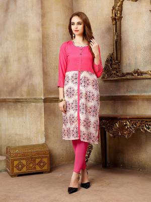 For Your Casual Wear, Grab This Readymade Kurti In Dark Pink Color Fabricated On Rayon Beautified With Prints. It Is Light In Weight And Available In All Sizes.