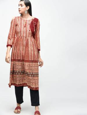 Add This Readymade Kurti For Your Semi-Casuals In Light Brown Color Which Is Cotton Based Beautified With Prints All Over.