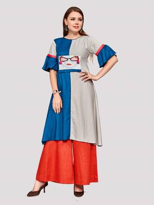 Be Its Your College, Home Or Work Place, This Readymade Kurti In Blue And Grey Color Is Suitable For All. It Is Fabricated On Rayon And Avialble In All Sizes.