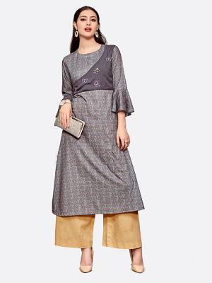 Here Is A Pretty Readymade Kurti To Add Into Your Wardrobe With This Designer Readymade Kurti In Grey Color Fabricated On Polyester Blend Beautified With Prints All Over.