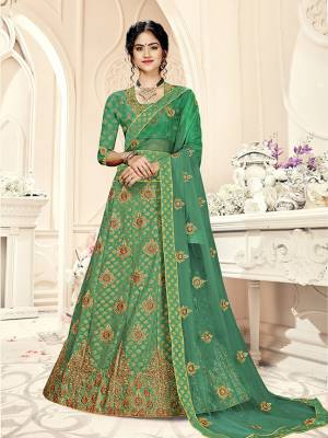 Grab This Heavy Designer Lehenga Choli In All Over Green Color. Its Blouse Is Fabricated On Art Silk Paired With Jacquard Silk Fabricated Lehenga And Net Fabricated Dupatta. It Is Beautified With Weave And Embroidery Which Is Making It More Attractive.