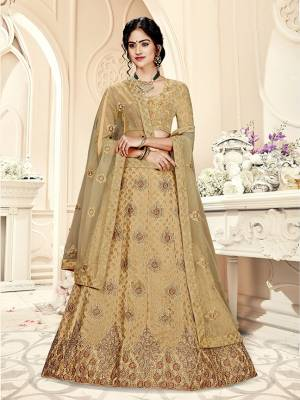 Grab This Heavy Designer Lehenga Choli In All Over Beige Color. Its Blouse Is Fabricated On Art Silk Paired With Jacquard Silk Fabricated Lehenga And Net Fabricated Dupatta. It Is Beautified With Weave And Embroidery Which Is Making It More Attractive.