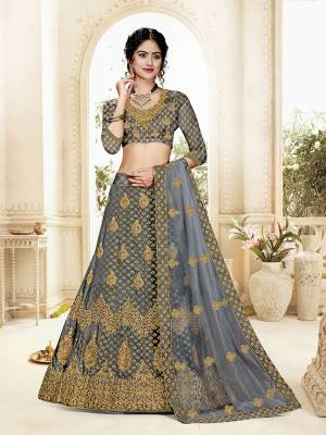 Grab This Heavy Designer Lehenga Choli In All Over Dark Grey Color. Its Blouse Is Fabricated On Art Silk Paired With Jacquard Silk Fabricated Lehenga And Net Fabricated Dupatta. It Is Beautified With Weave And Embroidery Which Is Making It More Attractive.