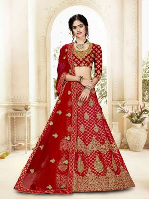 Grab This Heavy Designer Lehenga Choli In All Over Red Color. Its Blouse Is Fabricated On Art Silk Paired With Jacquard Silk Fabricated Lehenga And Net Fabricated Dupatta. It Is Beautified With Weave And Embroidery Which Is Making It More Attractive.