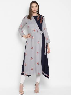 Designer Patterned Readymade Kurti Is Here In Grey And Navy Blue Color Fabricated On Rayon. It Is Beautified With Prints And Thread Work.