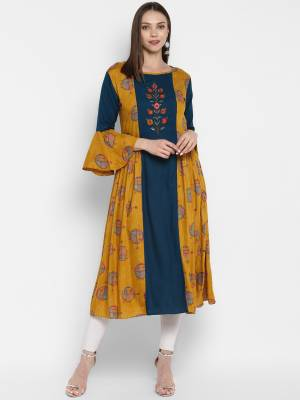 Grab This Very Beautiful Designer Readymade Kurti In Musturd Yellow And Blue Color Fabricated On Rayon. It Is Beautified With Prints And Thread Work.