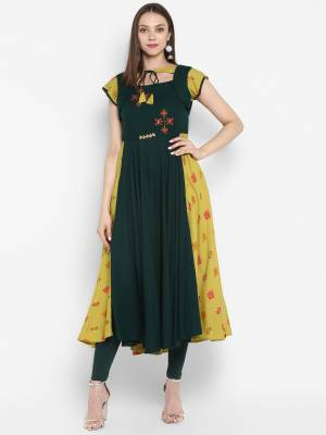 New Shade Is Here With This Designer Readymade Kurti In Pine Color. This Pretty Patterned Kurti Is Fabricated On Rayon Beautified with Prints And Thread Work. Its Fabric Is Light Weight And Easy To Carry All Day Long.