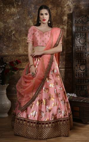Here Is A Very Pretty Designer Lehenga Choli In Peach Color Its Beautiful And Attractive Looking Blouse And Lehenga Are Fabricated On Art Silk Paired With Orgenza Fabricated Dupatta. It Is Beautified With Foil Print And Embroidery.