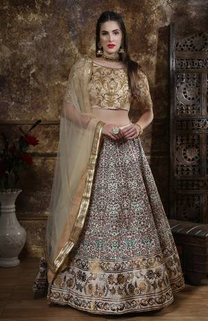 Flaunt Your Rich And Elegant Taste Wearing This Heavy Designer Lehenga Choli In Cream Colored Blouse Paired With Off-White Lehenga And Dupatta. Its Blouse And Lehenga are Fabricated On Art Silk Paired With Net Fabricated Dupatta.